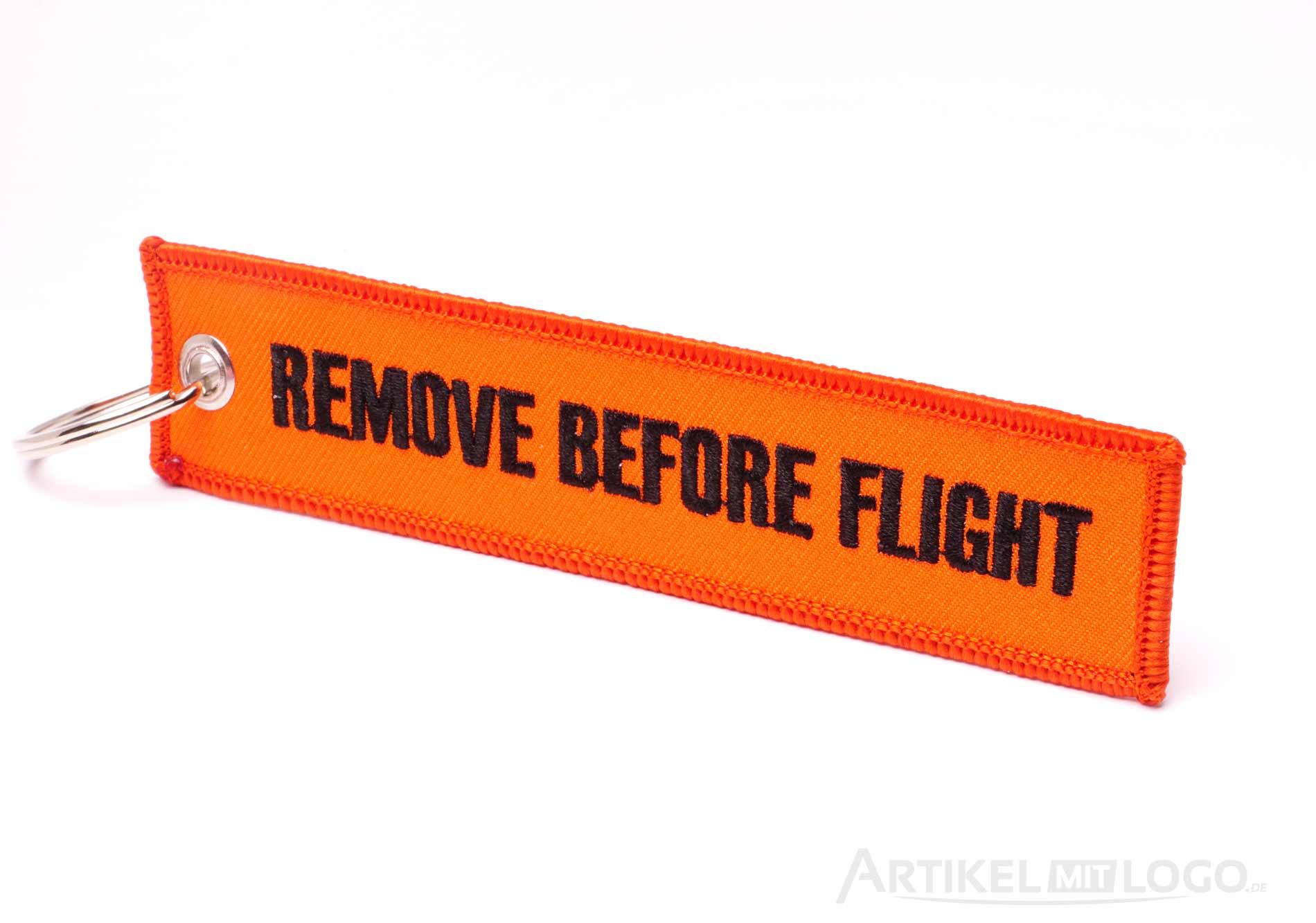 Remove Before Flight Schluesselanhaenger neon orange