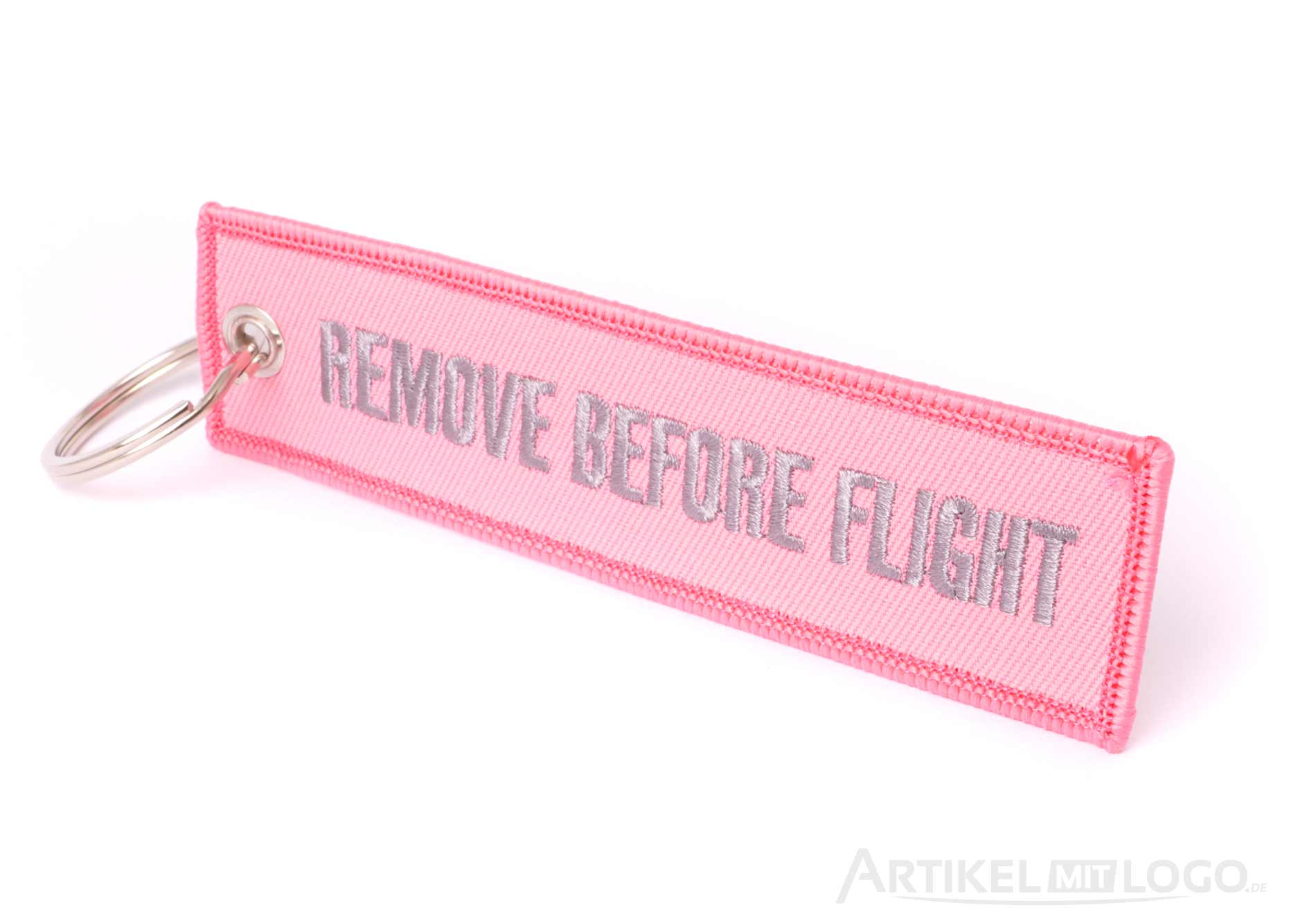 Remove Before Flight Schluesselanhaenger pink grau